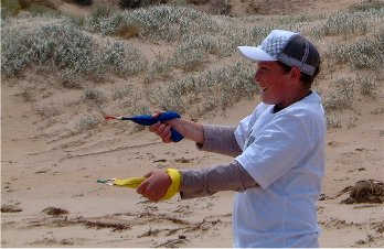 Daniel flying the penguin kite